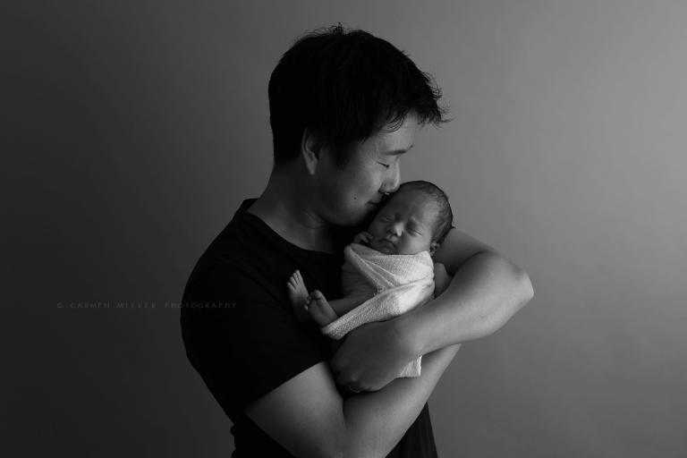 baby girl with dad newborn photographer seattle