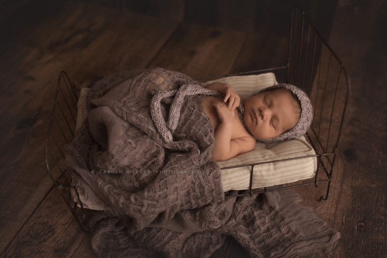 seattle newborn photographer girl on vintage bed